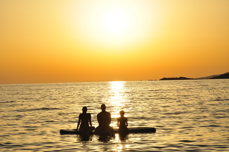 paddle boarding with kids sunset